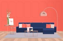 Interior design di un salone lussuoso con un sofà blu contro lo sfondo di una parete di corallo Illuminazione piana di vettore immagine stock