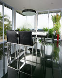 Interior design - dining. Dining area with full height windows Royalty Free Stock Photo