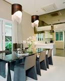 Interior design - dining. Dining area with pendent lighting Stock Image