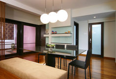 Interior design - dining. Dining area with pendant lighting Stock Images