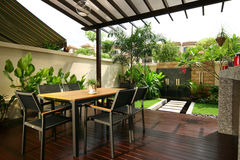 Interior design - dining. Outdoor dining area with timber decking royalty free stock photo
