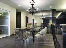 Interior design - dining area. Dining area with pendent light Stock Photos