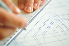 Interior design drawings. Designer's hand with pencil Royalty Free Stock Images