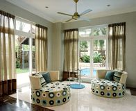 Interior design - family area. Family area with swimming pool behind Royalty Free Stock Photography