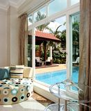 Interior design - family area. Family area with swimming pool outside Royalty Free Stock Photography