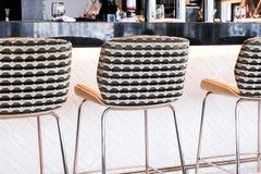 Modern bar stool in a luxury restaurant. Interior design, furniture decor and nightlife concept - Modern bar stool in a luxury restaurant stock photos