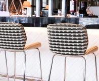 Modern bar stool in a luxury restaurant. Interior design, furniture decor and nightlife concept - Modern bar stool in a luxury restaurant stock image