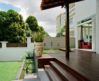 Interior design - garden. Garden with timber decking and shelter royalty free stock photos
