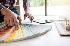 Interior design or graphic designer working on project of architecture drawing with work tools and color swatches, colour chart i. N digital tablet at workplace stock images