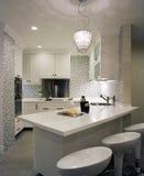 Interior design - kitchen. White kitchen cabinets with mosaic tiles Royalty Free Stock Photos