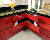 Interior design - kitchen. Kitchen cabinet in red spray paint Royalty Free Stock Images