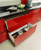 Interior design - kitchen. Kitchen cabinets in red spray paint Royalty Free Stock Photography
