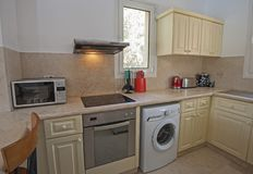 Interior design of luxury apartment kitchen. Kitchen area in luxury apartment show home showing interior design decor furnishing Stock Photo