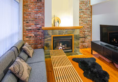 Interior design of a luxury living room. With a brick wall and fireplace Royalty Free Stock Photo