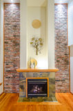Interior design of a luxury living room. With a brick wall and fireplace Royalty Free Stock Images