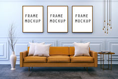 Modern vintage interior with Mock up poster  ,living room, Brown leather sofa  on dark  concrete flooring and classic blue wall ,F Stock Photo