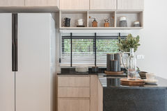 Interior design of new decorated wooden kitchen in luxury home Stock Photography