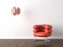 Interior design orange armchair on white. Interior design of modern orange armchair and lamp against a white wall with copy scape Stock Images