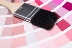 Interior design - paint brush and colorful palette with red colo Stock Photography
