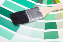 Interior design - paint brush and colorful palette with vivid co Royalty Free Stock Image