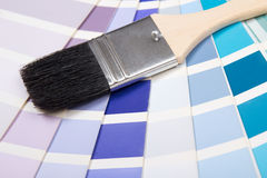 Interior design - paint brush over colorful palette with vivid c Royalty Free Stock Photo