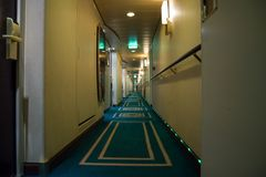 Passenger deck hallway with living cabins rooms on board of cruise ship royalty free stock photos