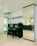 Interior design - piano. Entertainment area with upright piano Stock Photos