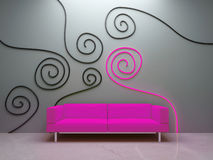 Interior design - Pink couch and decorated wall Stock Image