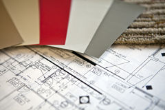 Interior Design Plans. Color swatches and samples on a set of blueprints for interior designers Royalty Free Stock Photos