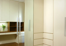 Interior design - wardrobe. Walk in wardrobe with mirror and drawers Royalty Free Stock Image