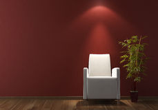 Interior design white armchair on bordeaux wall Royalty Free Stock Photo