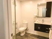 Interior design in luxury bathroom with hairdryer. Interior design in white luxury bathroom with hairdryer royalty free stock photos