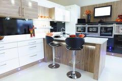 Interior designed home kitchen. Modern new interior designed home kitchen Royalty Free Stock Photos