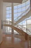 Interior designed staircase. Architectural details of modern interior designed staircase in front of panoramic window Royalty Free Stock Photography