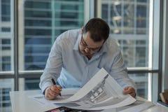 Interior designer adding comments. Royalty Free Stock Photos