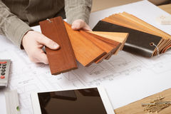 Interior designer choosing a baseboard Royalty Free Stock Photography