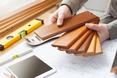 Interior designer choosing a baseboard Stock Photography