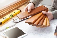 Interior designer choosing a baseboard Stock Photography