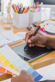 Interior designer with graphics tablet and colour chart Royalty Free Stock Photo