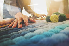 Interior designer hand choosing carpet sample Royalty Free Stock Photos