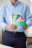 Interior Designer Holding Color Swatches Stock Images