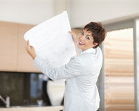 Interior designer holding a planning chart Royalty Free Stock Image