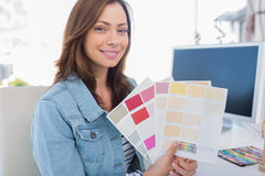 Interior designer holding up colour samples Royalty Free Stock Image