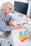 Interior designer looking at colour charts Stock Images