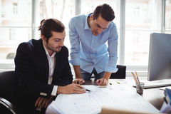 Interior designer with male colleague working in office Stock Photography