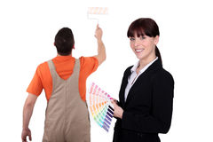 Interior designer with painter Stock Image
