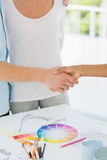 Interior designer shaking the hand of customer Royalty Free Stock Images