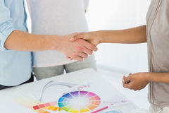 Interior designer shaking hands with customer Royalty Free Stock Photos