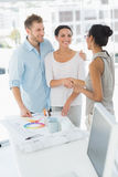 Interior designer shaking hands with smiling client Stock Photography
