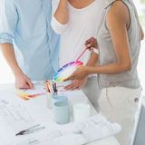 Interior designer showing colour wheel to client Royalty Free Stock Photos